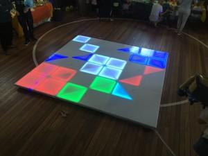 Light-up dance floor children dancing